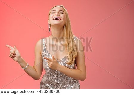 Funny Carefree Blond European Woman In Silver Glittering Evening Dress Raise Head Up Close Eyes Laug