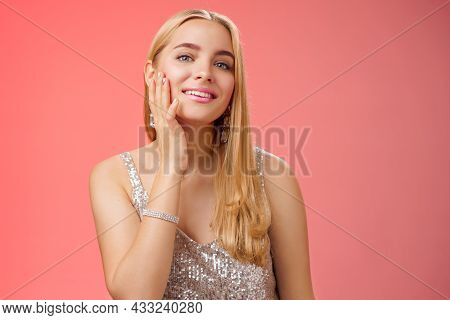 Tender Stylish Self-assured Coquettish Young Blond Wealthy Woman In Silver Shiny Dress Touching Pure