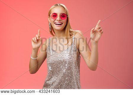 Stylish Carefree Fabulous Young Blond Woman In Silver Dress Red Sunglasses Having Fun Dancing Joyful