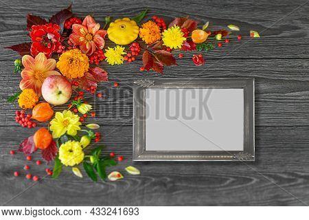 Vintage Photo Frame With Natural Autumn Orange Flowers Leaves And Pumpkins On A Dark Wooden Backgrou