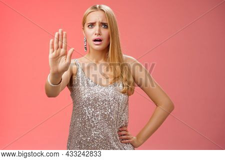 Freaked Out Displeased Bothered Insecure Blond Woman In Silver Glittering Dress Extend Palm Stop Eno