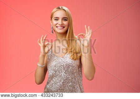 No Problem Friend. Charming Carefree Tender Blond European Woman In Silver Dress Show Okay Ok Gestur