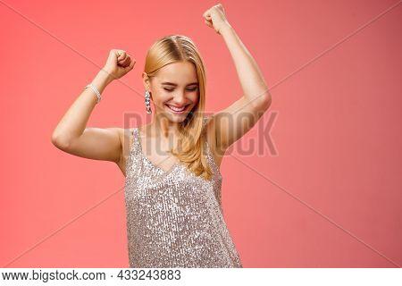 Joyful Blond Excited Birthday Girl Having Fun Carefree Dancing Raised Hands Close Eyes Smiling Enjoy
