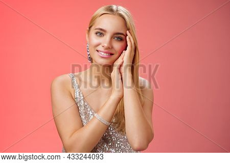 Tender Feminine Gentle Blond Woman In Silver Stylish Dress Touching Face Lovely Smiling Camera Caref