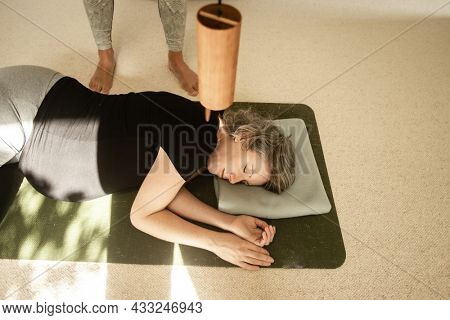 young pregnant woman practicing yoga in studio, maternity fitness, healthy lifestyle