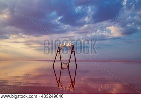 Swing In The Pink Salt Lake Sivash.  A Place In Ukraine For Treatment And Walks.