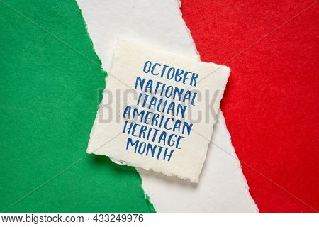 October - National Italian American Heritage Month, handwriting on handmade paper against abstract in colors of national flag of Italy (green, white and red), reminder of cultural event