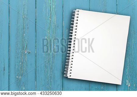 Blank Spiral Notepad With Copy Space On Rustic Wooden Table