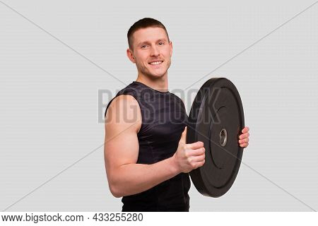 Sportsman With Barbell Pancakes In Hands. Man Doing Workout With Barbells. Man Workout. Sportsman St