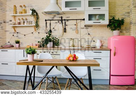 Modern Style Kitchen Interior With Furniture And Kitchen Utensils. In The Middle Of The Kitchen Is A