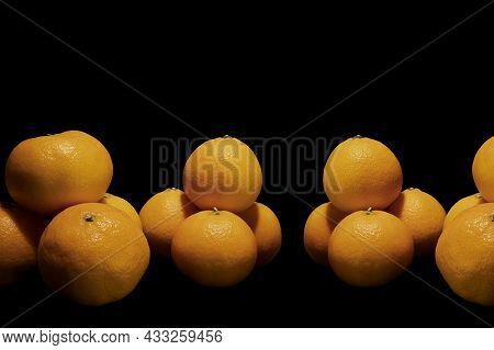 Mandarins On A Black Background With Free Space For Text.