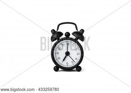 A Small Alarm Clock Isolated On White. 7 O'clock