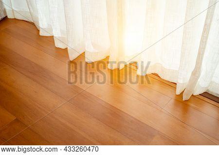 Light Shine Through The Curtain, Close-up Of Draperies At A Window. Shine Light Through The Curtains