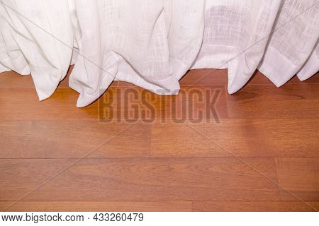 The Curtain Rod Was So Long That It Fell Onto The Wooden Floor Of The Room. The Curtains In The Bedr