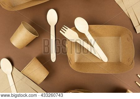 A Set Of Disposable Tableware And Wood Cutlery On Brown Background. Fast Food Containers. Eco-conser