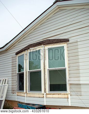 Three Bay Windows Are Being Taken Out And Will Be Replaced With Nice New Tinted Storm Windows And Sc