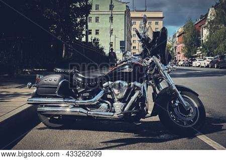 Yamaha Road Star Motorcycle Xv1600 Parked On The Street Of The City, Stylized In Matte Retro Style: