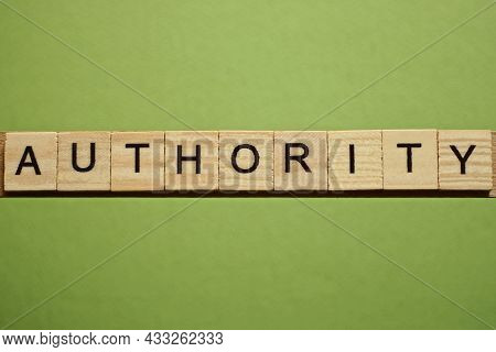 Gray Word Authority From Small Wooden Letters On A Green Table