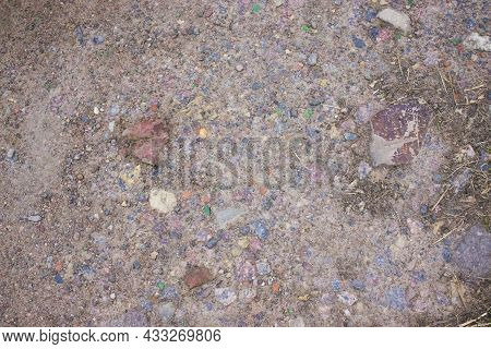 Small Stones And Sand. The Natural Texture Of The Soil. Shore Of A Reservoir With A Beach And Pebble
