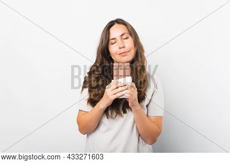 Portrait Of A Woman With Eyes Closed Enjoying The Smell Of Chocolate.