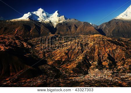 Huandoy Peaks (6395m) and Yungay village in Rio Santa Valley, Cordilera Blanca, Peru, South America