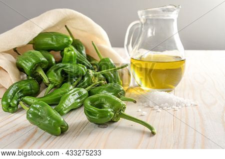 Fresh Green Padron Peppers Or Pimientos, Olive Oil And Coarse Sea Salt, Ingredients For A Spanish Ta