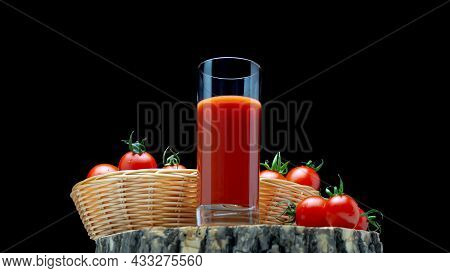 Tomato Juice On A Black Background, Fresh Tomatoes On A Wooden Board. Close-up Of Tomato Juice In A