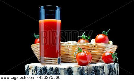 Tomato Juice With Tomatoes On A Wooden Board On A Black Background. Fresh Tomatoes In A Basket With