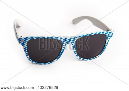 Sunglass In Bavarian Blue And White Colours Over Bright Background