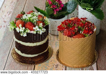Naked Chocolate Cake Next To Dress Cake Covered With Textured Board. Decorated With Strawberries And
