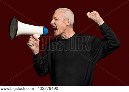 Male activist with a megaphone with design space