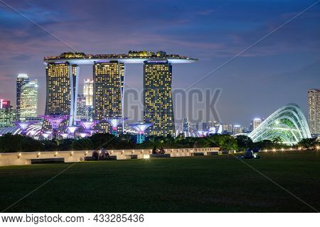 SINGAPORE, SINGAPORE - MARCH 2019: Vibrant Singapore skyline at night