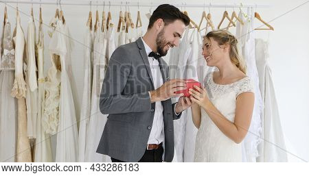 Romantic Love Of Man And Woman Couples Give Gift Boxes To The Bride.happy Bride And Groom In Wedding