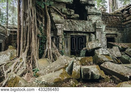 View Of Abandoned Ta Prohm Temple, One Of Angkor's Best Visited Monuments. It Is Known For The Huge