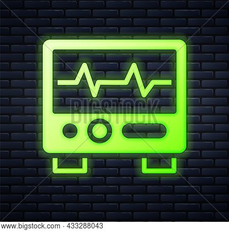 Glowing Neon Computer Monitor With Cardiogram Icon Isolated On Brick Wall Background. Monitoring Ico