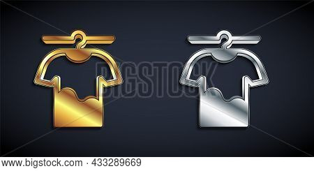 Gold And Silver Drying Clothes Icon Isolated On Black Background. Clean Shirt. Wash Clothes On A Rop