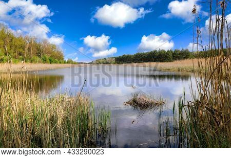 spring day on lake, nice sky with clouds over lake water surface. TAke it in Ukraine