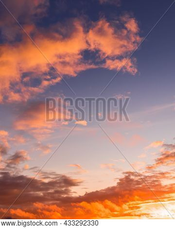 Colorful Dramatic Clouds Lit By A Sun Against The Sunset Or Sunrise Sky.