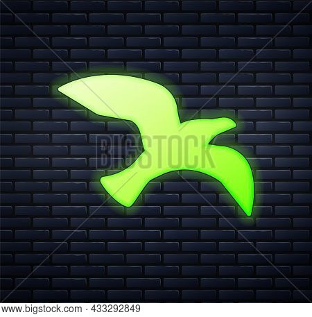 Glowing Neon Bird Seagull Icon Isolated On Brick Wall Background. Vector