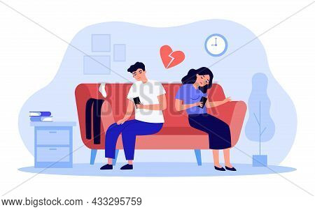 Bored Couple Sitting On Sofa While Looking At Their Phones. Husband And Wife Tired Of Each Other Fla