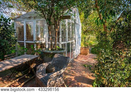 A Light And Airy Furnished Sun Room (conservatory) In Garden, In The Afternoon Have Sunlight. Englis