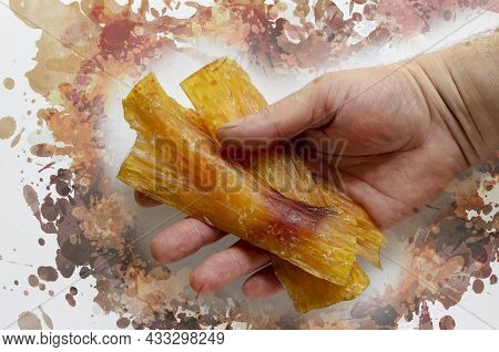Dried Beef Tendon In The Hand. Male Hand Holds Group Of Hypoallergenic Chewing Treats For Dogs. Pet