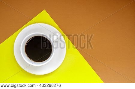 Black Coffee In A White Coffee Cup On A Gentle Background. Top View, Flat Lay, Copy Space. Cafe And