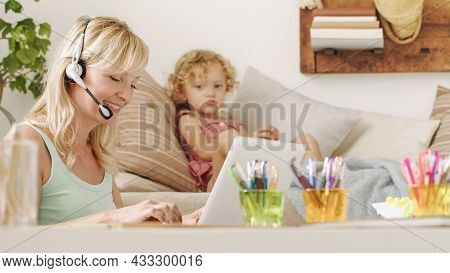 Smart Working, Mother Works On Computer At Home And Neglecting Her Daughter Child Who Is Unhappy And