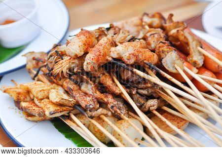 Barbecued Pork Or Spicy Barbecued Or Spicy Satay ,sausage And Meatball Dish