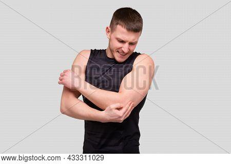 Sport Man Holding Elbow. Man Having Injury. Sport Man Elbow Injury