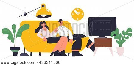 Young Family Couple Resting On Comfy Sofa In Living Room. Couple Spending Time Together, Watching Tv