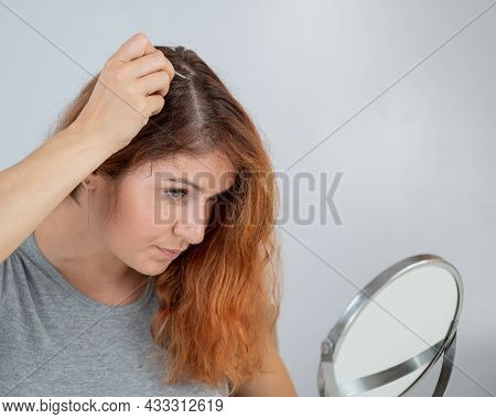Caucasian Woman Finds Gray Hair And Removes It With Tweezers. Signs Of Aging.