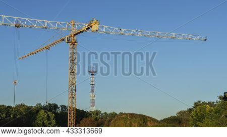 Panoramic View Of Construction Site In The City Centre With A Couple Of Tall Yellow Cranes For Lifti