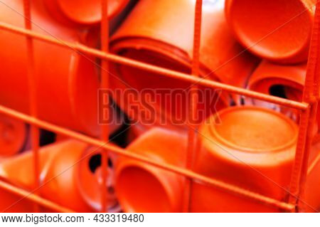 Red Metal Background From Aluminum Cans With Blurred Focus
